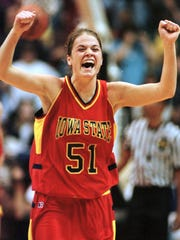 Former Iowa State guard Megan Taylor celebrates her team's 64-58 upset win over top seeded Connecticut in the 1999 NCAA Mideast Regional semifinals.