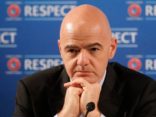 FILE - In this file photo dated Saturday, Feb 22, 2014, Gianni Infantino gestures during a press conference at the Acropolis Convention Centre in Nice, southeastern France.  FIFA President Gianni Infantino wants to team up with American, Chinese and Saudi Arabian interests to launch an expanded 24-team Club World Cup, played every four years starting in 2021, and a two-yearly global competition for national teams. (AP Photo/Lionel Cironneau, FILE)