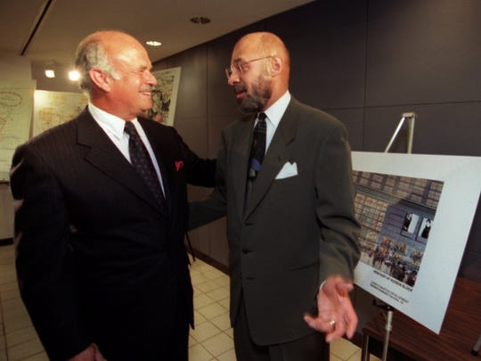 Compuware C.E.O. Peter Karmanos jr., and Mayor Dennis Archer talk about Compuware building and its corporate headquarters in downtown Detroit after a press conference in the City County Building.