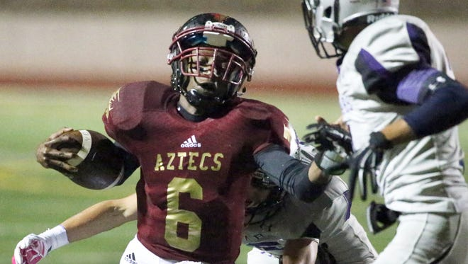 El Dorado quarterback Cedarious Barfield, 6, is hit from behind while keeping the ball against Franklin Friday night at the Socorro Activities Complex.