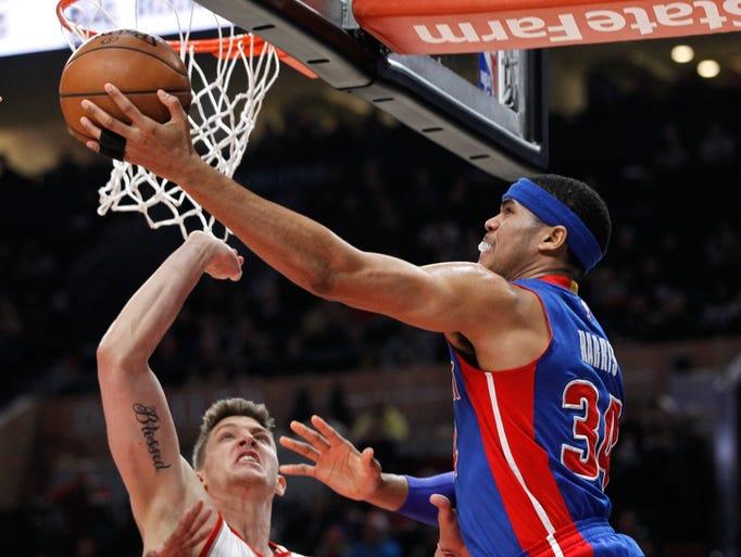 Detroit Pistons forward Tobias Harris, right, shoots