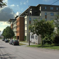 Original plan: The proposed Eagles Landing student housing project on St. Paul Street dwarfs adjacent buildings (in white) in this conceptual rendering. The development was rejected on April 1, 2014 by the Burlington Development Review Board.