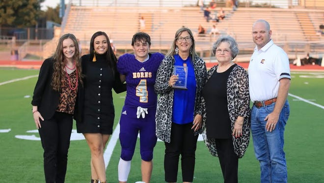 Vanessa Stewart, who was selected as a 2020 Longhorn Legend, is pictured with (from left) her children, Vance-Cady Gordon, Beale-Madison Gordon and John-Stewart Gordon; Linda Moseley who presented her with her Longhorn Legend award; and Early ISD superintendent Dr. Dewayne Wilkins.