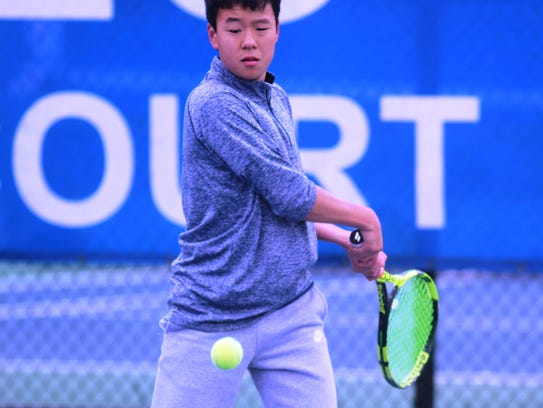Toshi Watanabe of Covington Latin hits the ball during