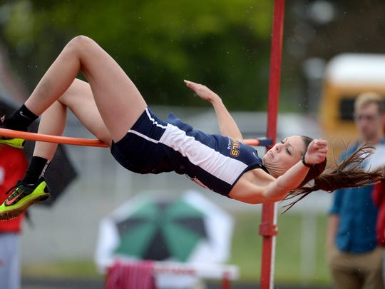 Seton Catholic's Julia Reichley competes in high jump during the girls track and field sectional Tuesday, May 17, 2016 in Connersville.