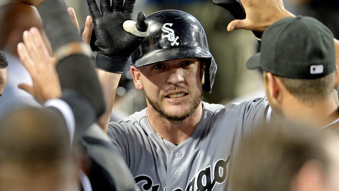 Chicago White Sox catcher Tyler Flowers (21) is greeted in the dugout after a home run in the fourth inning of the game against the Los Angeles Dodgers at Dodger Stadium.