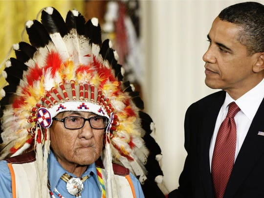President Barack Obama presents the 2009 Presidential Medal of Freedom to Joseph Medicine Crow during ceremonies at the White House in Washington.