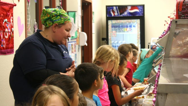 During lunchtime at Ralph Williams Elementary in Viera, cafeteria manager Jamie Skinner helps kindergartners and first-graders through the line, making sure each one takes a helping of fruit or veggies. Skinner is Brevard's 2017 Employee of the Year.