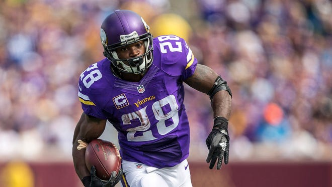 Minnesota Vikings running back Adrian Peterson (28) rushes with the ball in the second half against the Detroit Lions at TCF Bank Stadium.