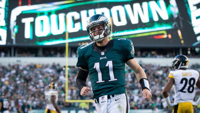 Sep 25, 2016; Philadelphia, PA, USA; Philadelphia Eagles quarterback Carson Wentz (11) reacts after his 73 yard touchdown pass against the Pittsburgh Steelers during the third quarter at Lincoln Financial Field.