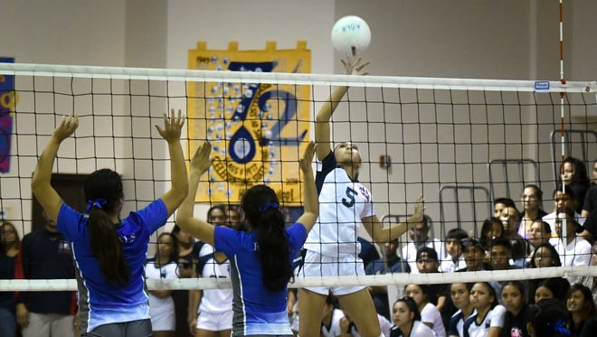 The Academy of Our Lady of Guam Cougars played the Notre Dame Royals in an IIAAG Girls' Volleyball League match in Hagåtña on Oct. 4.
