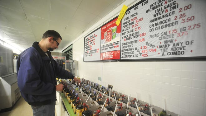 Chris Davis prepares snack trays for children at the Springmill Drive-In Theater in Mansfield.