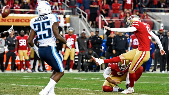 49ers placekicker Robbie Gould (9) kicks the game-winning field goal Sunday as time expires to defeat the Titans 25-23 at Levi's Stadium.