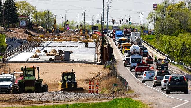 Traffic on Minnesota Highway 24 is down to one lane as construction on a new bridge over the Mississippi River continues Tuesday, May 9, in Clearwater.
