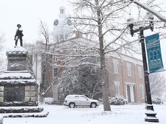 The Rutherford County Courthouse in Murfreesboro is covered in snow as a winter snow storm hits Rutherford County on Friday, Jan. 22, 2016.