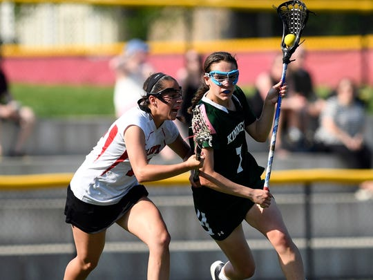Kinnelon's Taylor Smith, right, with pressure from Glen Rock's Emily Reed. Glen Rock defeats Kinnelon 15-7 in the North 1, Group 1 quarterfinals on Thursday, May 18, 2017.