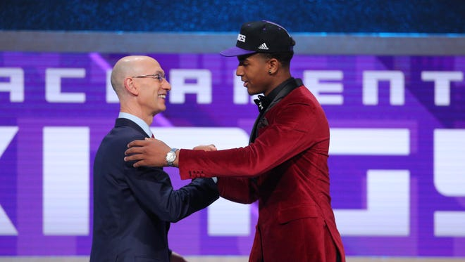 Marquese Chriss (Washington) greets NBA commissioner Adam Silver after being selected as the number eight overall pick.