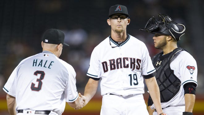 Diamondbacks' Tyler Clippard hands over the ball to manager Chip Hale on Friday, June 10, 2016, at Chase Field in Phoenix.