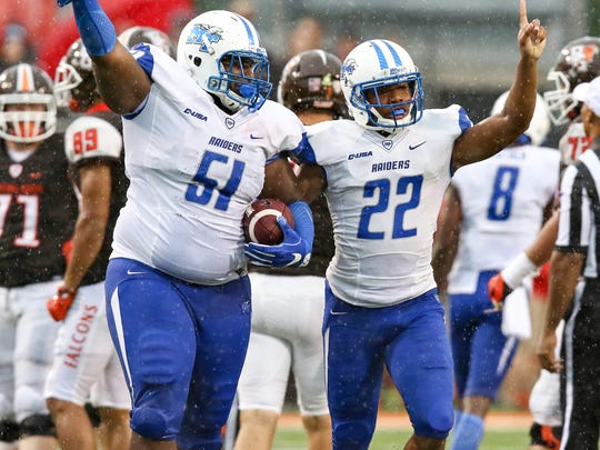 Shaq Huff (51) recovered a fumble which led to MTSU taking a halftime lead.
