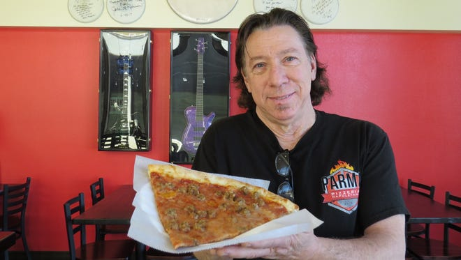 Mick Mahan, a professional bassist who performed with the Pat Benatar band, is the owner of Parma Pizzeria Napoletana in Thousand Oaks.