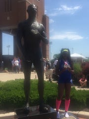 Alysse Wade and Jesse Owens and their seven gold medals.