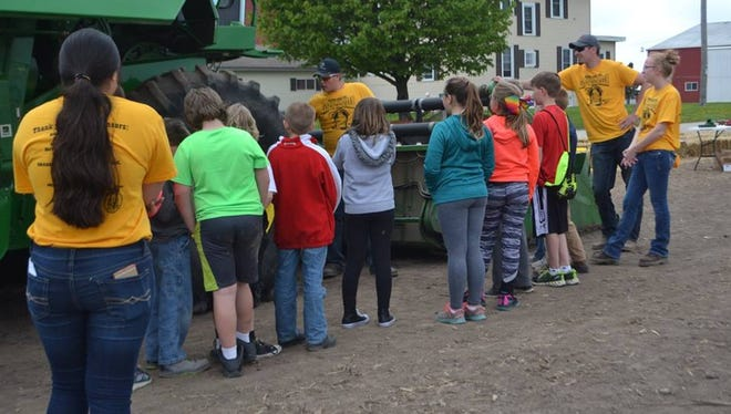 Waupun FFA members Logan Pluim and Devin Zimmerman talk to Waupun School District Elementary students about Agriculture Equipment Safety at the 20th annual Waupun FFA Day On the Farm program.