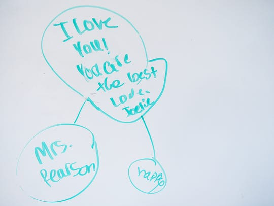 A message to a teacher on a whiteboard at Mills River