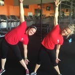 Magen Wooley and Leslie Maxwell, certified personal trainers with Around the Clock Fitness in Fort Myers, strengthen the QL in modified Triangle Pose.