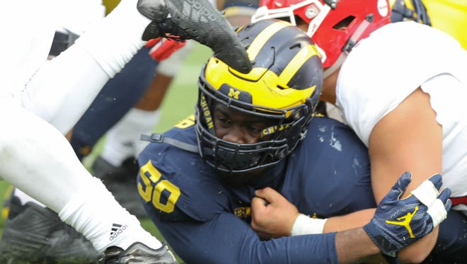 Michigan's Michael Dwumfour is blocked trying to tackle a Rutgers player in the fourth quarter Saturday, Oct. 28, 2017 at Michigan Stadium.