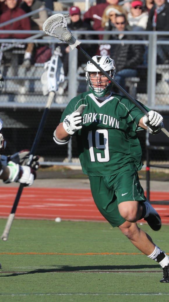 Scarsdale's Noah Glantz pressures Yorktown's Brett