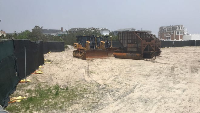 Beach replenishment equipment awaits upcoming use on Bethany Beach on Thursday, May 31, 2018.