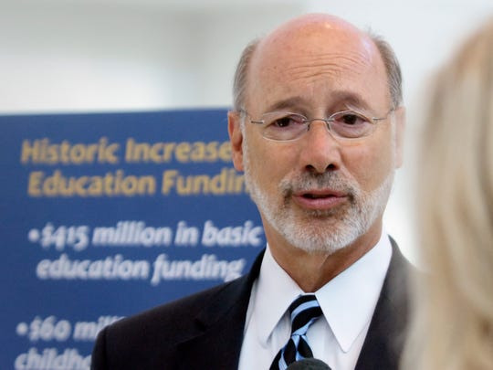 In this file photo, Gov. Tom Wolf talks with the media