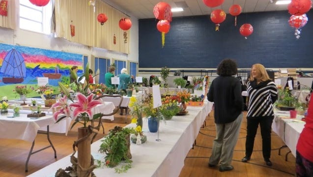 Tables with entries at the 2014 Community Flower Show in Nyack.