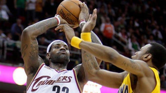 LeBron James, here in his Cleveland days, shooting over the Pacers. Expect more of this next season