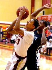 Riverdale's Rashaad Thompson (21) goes up for a shot