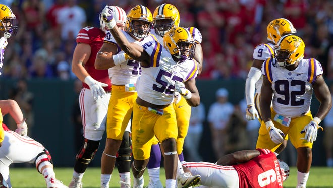 LSU Tigers linebacker Kendell Beckwith (52) celebrates following a play during the third quarter against the Wisconsin Badgers at Lambeau Field. LSU lost 16-14.