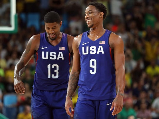 Aug 6, 2016; Rio de Janeiro, Brazil; United States guard Paul George (13) and United States guard Demar DeRozan (9) talk during the game against China in the men's basketball group A  preliminary round during the Rio 2016 Summer Olympic Games at Carioca Arena 1.