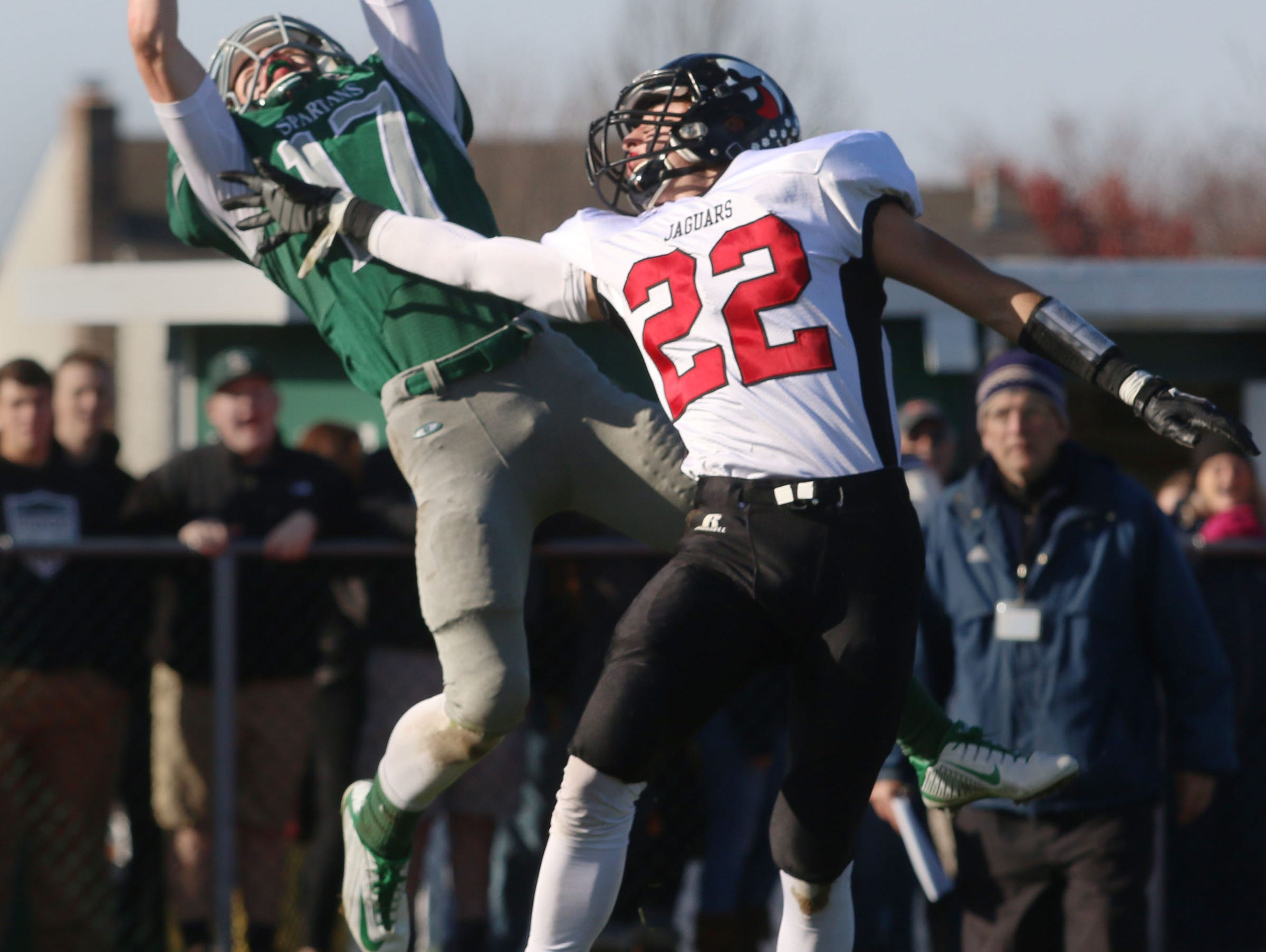 Jackson Memorial's Kyle Lona (22) defends on a pass attempt to Steinert's Conner Braddock in the end zone. Jackson Memorial vs Steinert NJSIAA Central Group IV semifinal game. Hamilton Township, NJ Saturday, November 21, 2015 @dhoodhood