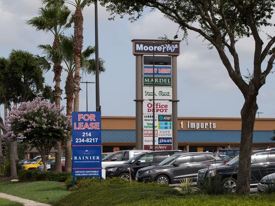 A For Lease sign at Moore Plaza along SPID on Monday,