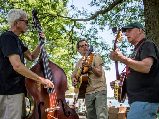 John Denomme, Jerry Castle and Dennis Cyporyn perform as the Dennis Cyporyn Band in Palmer Park during the St. Clair Art Fair Saturday, June 25, 2016, in St. Clair.