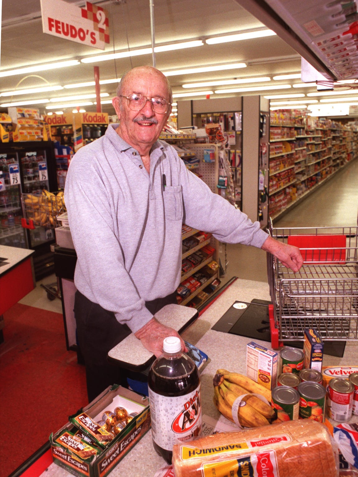 Joe Feudo, original owner of the Feudo's Food stores, buys groceries Feb. 25, 1999. The current owners were closing the store later that year.