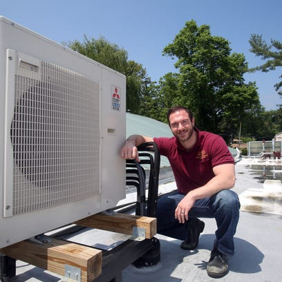 Robert Clarke with A. Borrelli Mechanical of Pleasantville, services an air conditioner at the Andrus nursing home in Hastings-On-Hudson on May 15.