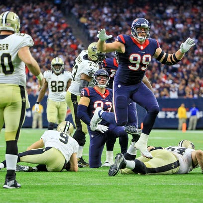 Texans defensive end J.J. Watt (99) celebrates after sacking Saints quarterback Drew Brees during Sunday's game at NRG Stadium in Houston. The Texans defeated the Saints 24-6.