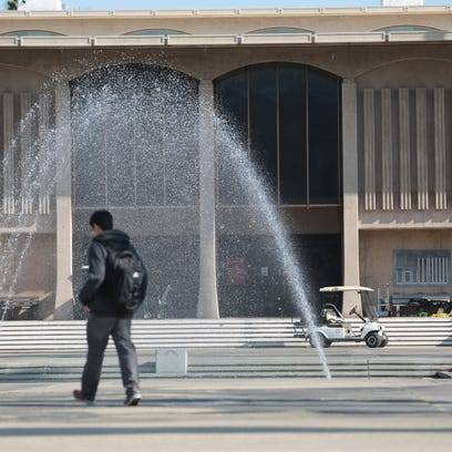 A student walks by the fountain in front of the administration building at College of the Desert. COD's Board of Trustees is  pushing ahead with its plan to create a new West Valley Campus at the mostly empty Palm Springs Mall.