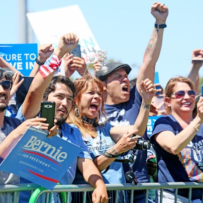 Supporters cheer while listening to Democratic presidential candidate Sen. Bernie Sanders speak at a rally on Sunday in Vista, Calif.