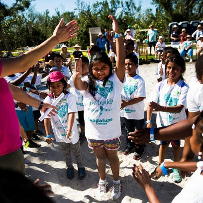 Immokalee kids and their big buddies spend day at Marco Island beach