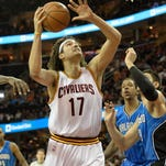 Cleveland Cavaliers center Anderson Varejao (17) drives to the basket against the Orlando Magic in the third quarter at Quicken Loans Arena.