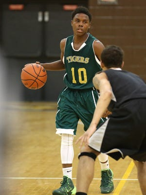 Crispus Attucks' Donte Reed moves the ball up the court  during a scrimmage against Howe Friday November 21, 2014.