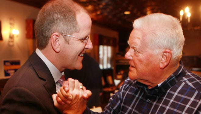 Kris Knochelmann (left), who defeated incumbent Steve Arlinghaus for Kenton County judge-executive, is congratulated by supporter David Chadwick, of Independence at Walt's Hitching Post, Fort Wright.
