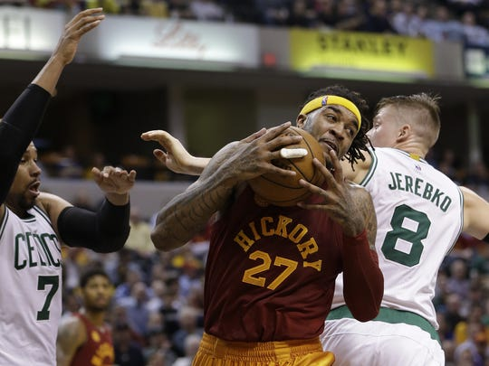 Indiana Pacers center Jordan Hill (27) fights for the rebound against Boston Celtics center Jared Sullinger (7) at Bankers Life Fieldhouse in Indianapolis on March 15, 2016.